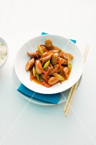 Stir-fried vegetables with hot dog sausages