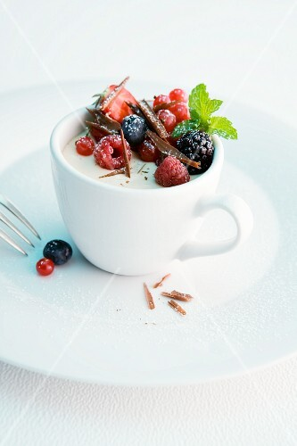 Cappuccino parfait with fresh berries and chocolate curls