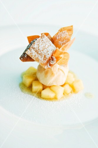 A ricotta parcel on a bed of apple ragout