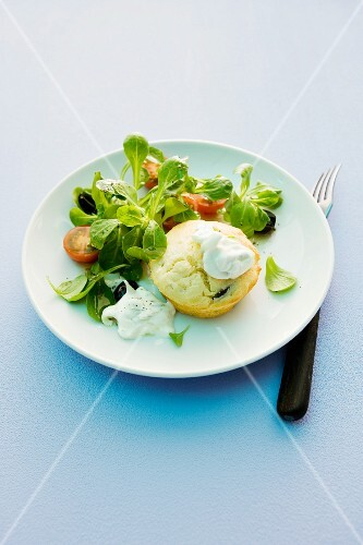 A muffin with tzatziki and salad