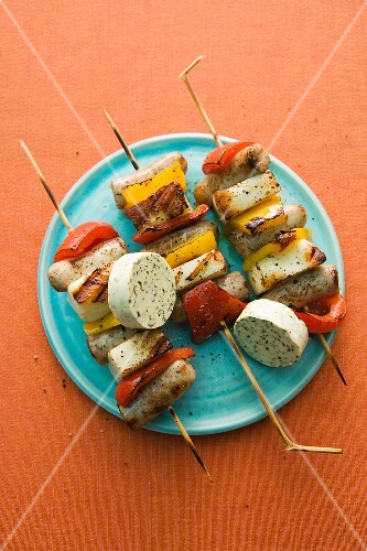 Grilled haloumi skewers with sausages, pepper and herb butter