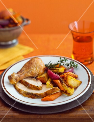 Freshly roasted turkey with root vegetables