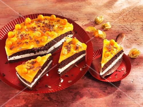 Sea-buckthorn cream cheesecake with physalis, sliced