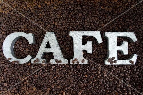 The word 'cafe' on coffee beans