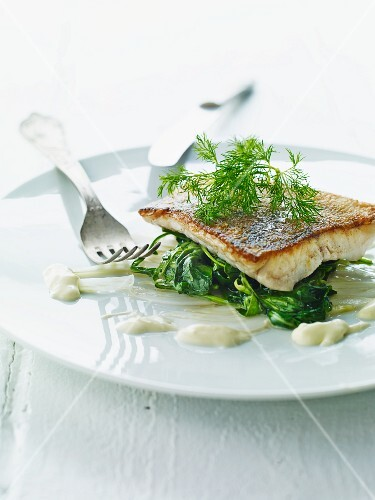 A fish fillet on a bed of spinach for Easter