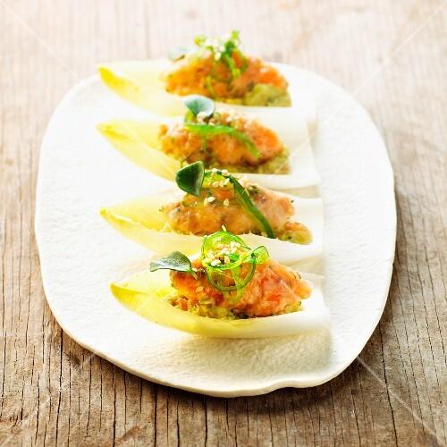 Chicory boats with guacamole, salmon salad and wakame