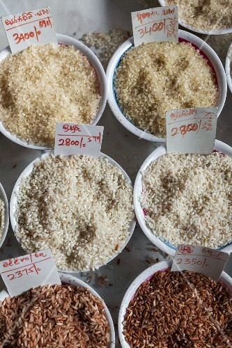 Various types of rice in bowl with price labels (Sri Lanka)