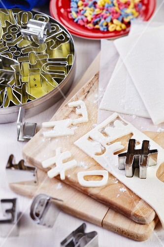 Letters cut out of puff pastry and alphabet pastry cutters