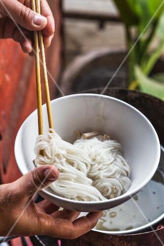 Noodles in a soup bowl, Thailand