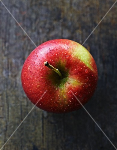 An apple on a wooden surface