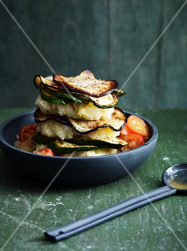A tower of vegetables with tomatoes