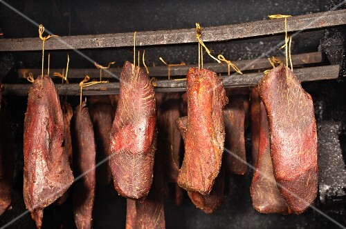 Cold smoked beef in a smoking chamber