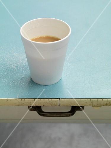 A cup of tea on a light blue cloth