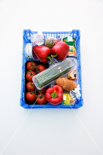 Vegetables and convenience food in a shopping basket
