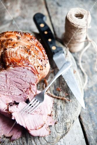 Homemade roast ham with a honey-mustard glaze, sliced