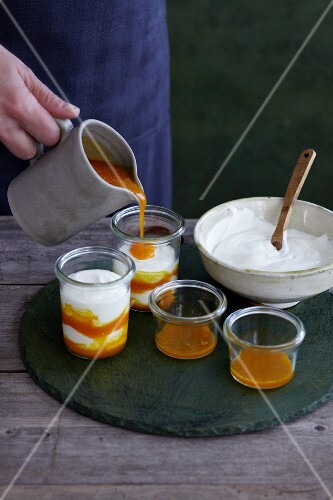 Sea-buckthorn mousse being poured over yogurt
