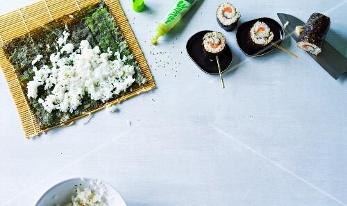 Sushi on sticks being made