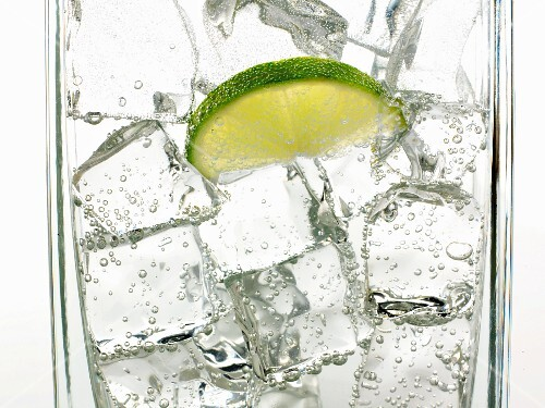Mineral water with ice cubes and a slice of lime