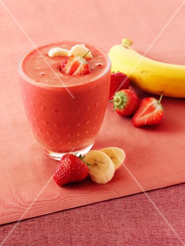 A glass of strawberry and banana smoothie
