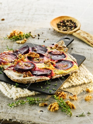 Tarte flambée with beetroot and walnuts