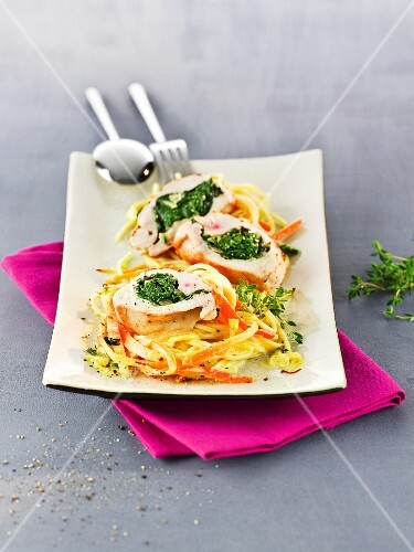 Stuffed chicken breast on saffron spaghetti