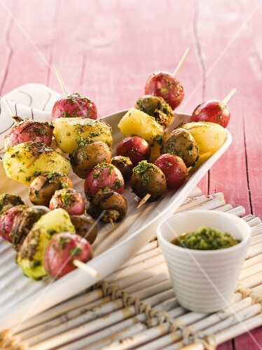 Potato skewers with radishes and pesto