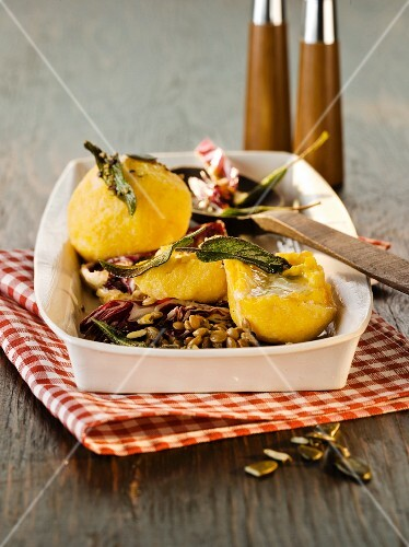 Pumpkin dumplings filled with cheese, sage and radicchio