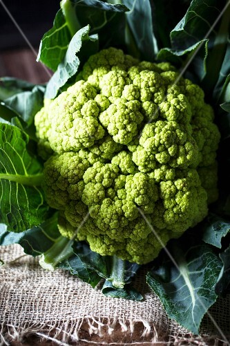 Green cauliflower on a piece of jute