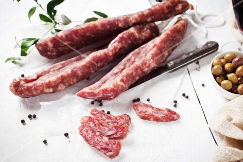Llonganissa (Spanish smoked sausage), olives and peppercorns
