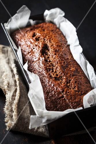 Walnut bread in a loaf tin