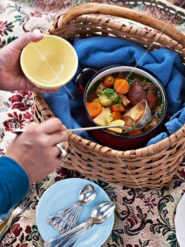 A soup pot in a picnic basket