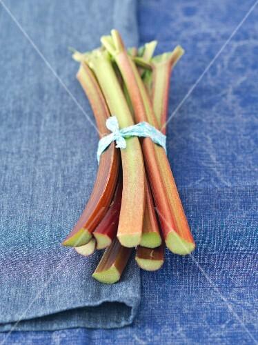 Rhubarb sticks on a blue table