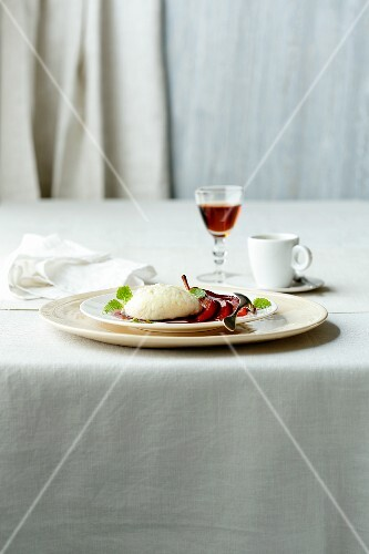 Lemon mousse with red wine pears