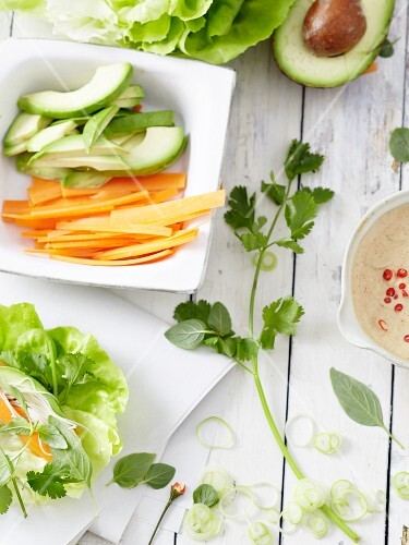 Ingredients for lettuce rolls with a vegetable filling and a peanut dip