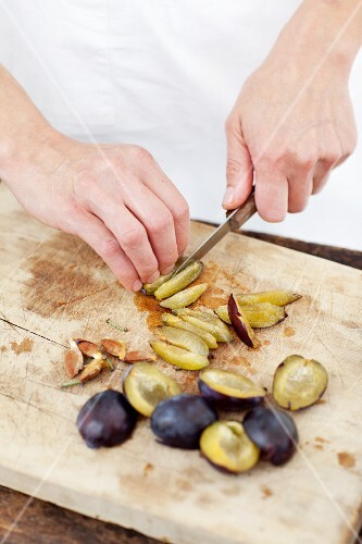 Pitted plums being chopped