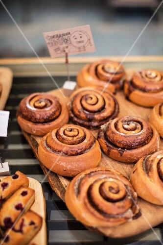 Cinnamon buns on a wooden board
