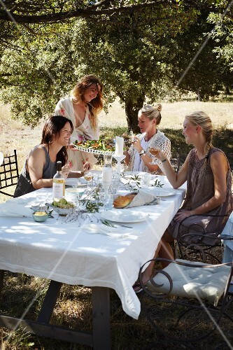 A table laid for a Provençal meal in a garden