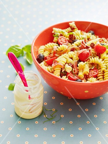 Mediterranean pasta salad with tomatoes and ham