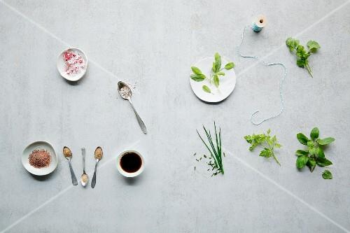 An arrangement of various types of salt and fresh herbs