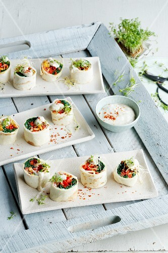Chicken wraps filled with tempeh and vegetables