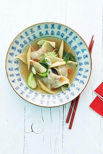 Wonton soup in an oriental bowl