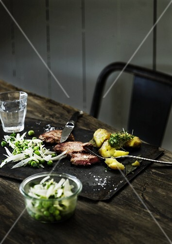 Beef steak with potatoes and a pea salad