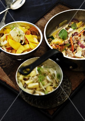 Various salads on a buffet and a spicy fried dish