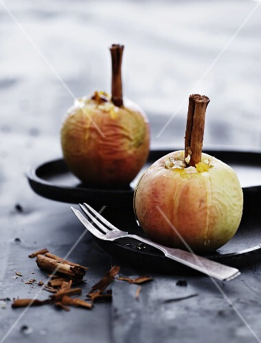 Stuffed baked apples with cinnamon sticks