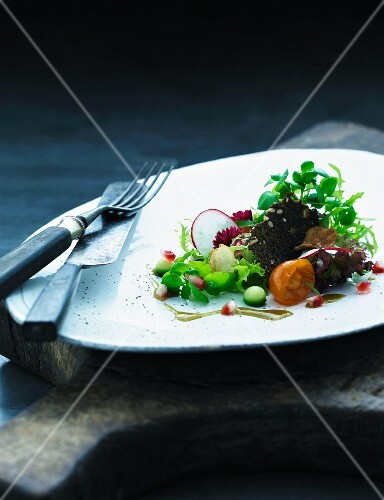 A small salad with rye bread