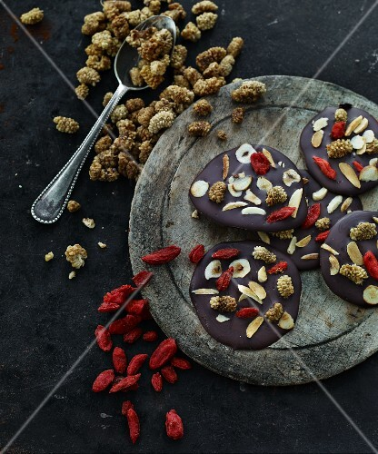 Chocolate disks with dried goji berries, mulberries and nuts