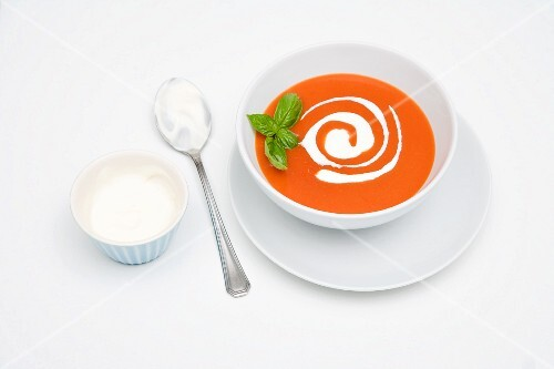 Cream of tomato soup with sour cream and basil