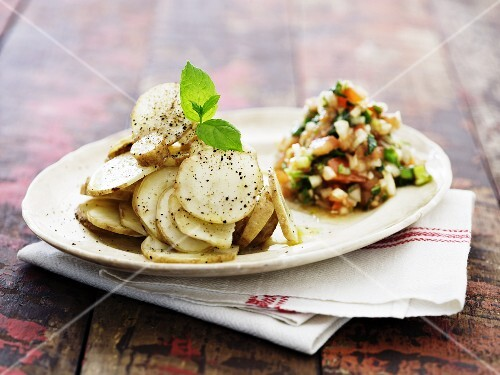 Roasted Jerusalem artichoke slices with a vegetable salad