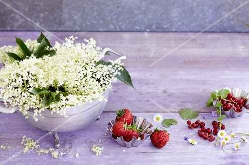 A summer arrangement featuring elderflowers and fresh berries