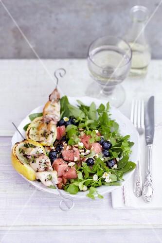 Squid skewers on a wild herb salad